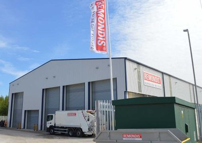 Front of REMONDIS Facility with Waste Lorry and Skip Outside