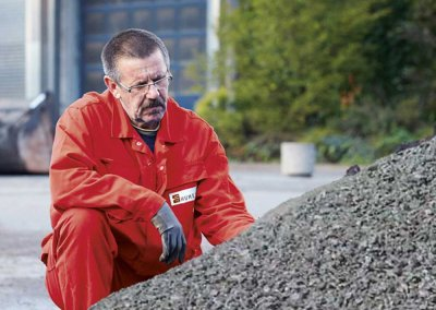 REMONDIS Worker Looking At Aggregate